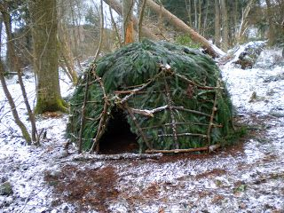 Guy builds 100 Wild Huts as an experimental challenge, then slept in each shelter for one night, and blog about the experiences.
