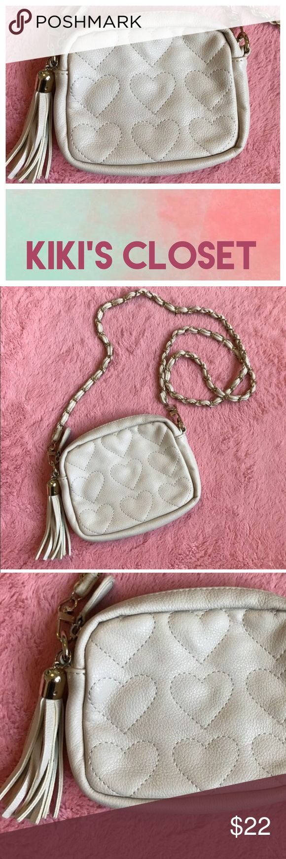 🚨PRICE DROP🚨F 21 HEARTS QUILT CROSS BODY BAG 💗Condition: EUC, No flaws Color:cream/beige 💗Smoke free home 💗No trades, No returns 💗No modeling  💗Shipping next day 💗I LOVE OFFERS, offer me! 💗BUNDLE and save more 💗All transactions video recorded to ensure quality.  💗Ask all questions before buying Forever 21 Bags Crossbody Bags