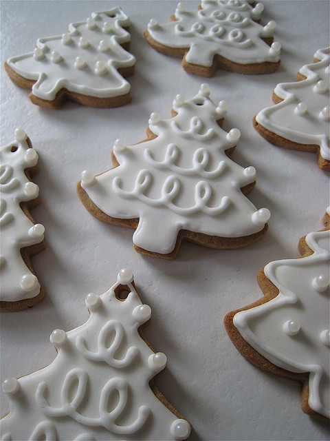 White iced christmas tree biscuits / cookies