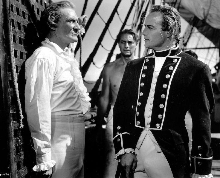 """Mutiny on the Bounty"" (1962) People: Marlon Brando, Trevor Howard Characters: Captain William Bligh, 1st Lt. Fletcher Christian"
