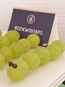 The bookworms are soooo easy to make. Simply skewer grapes onto a wooden skewer, then dab some frosting onto mini chocolate chips for eyes.