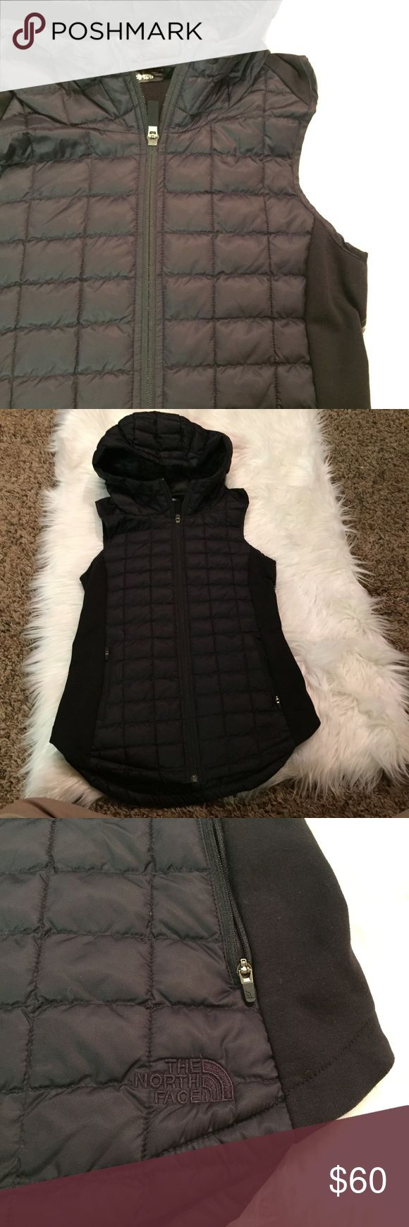 NWOT The North Face Thermoball hooded vest Brand new without tags. Perfect condition. The North Face Thermoball black hooded vest, size XS. Keeps you warm even when wet. The North Face Jackets & Coats Vests