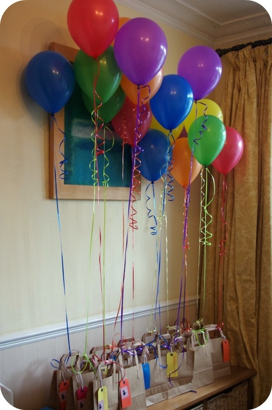 Neat idea for a kid's birthday party, tie balloons to favor bags. They will be festive party decor, plus every kid wants to take home a balloon!