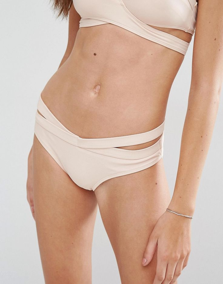 Buy it now. Noisy May Tan Lines Nude Wrap Bikini Bottom - Beige. Bikini briefs by Noisy May, Stretch swim fabric, Wrap style, Low-rise cut, Machine wash, 82% Polyamide, 18% Elastane, Our model wears a UK S/EU S/US XS. ABOUT NOISY MAY The younger and louder sibling of Danish brand Vero Moda, Noisy May is your new go-to label for fashion-forward denim. Their first collection sees authentic, raw, cutting-edge jeans sit alongside a trend-led range of knits, tops and sweatshirts in punch-packing…