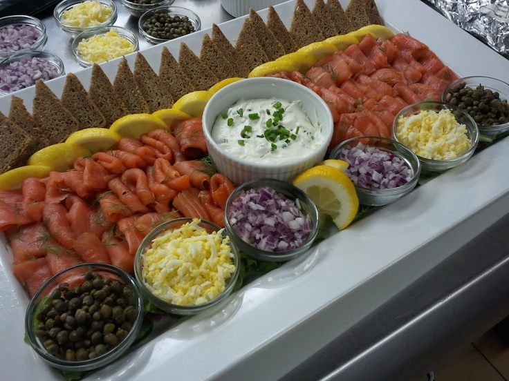 smoked salmon platter with red onion, capers, and onion