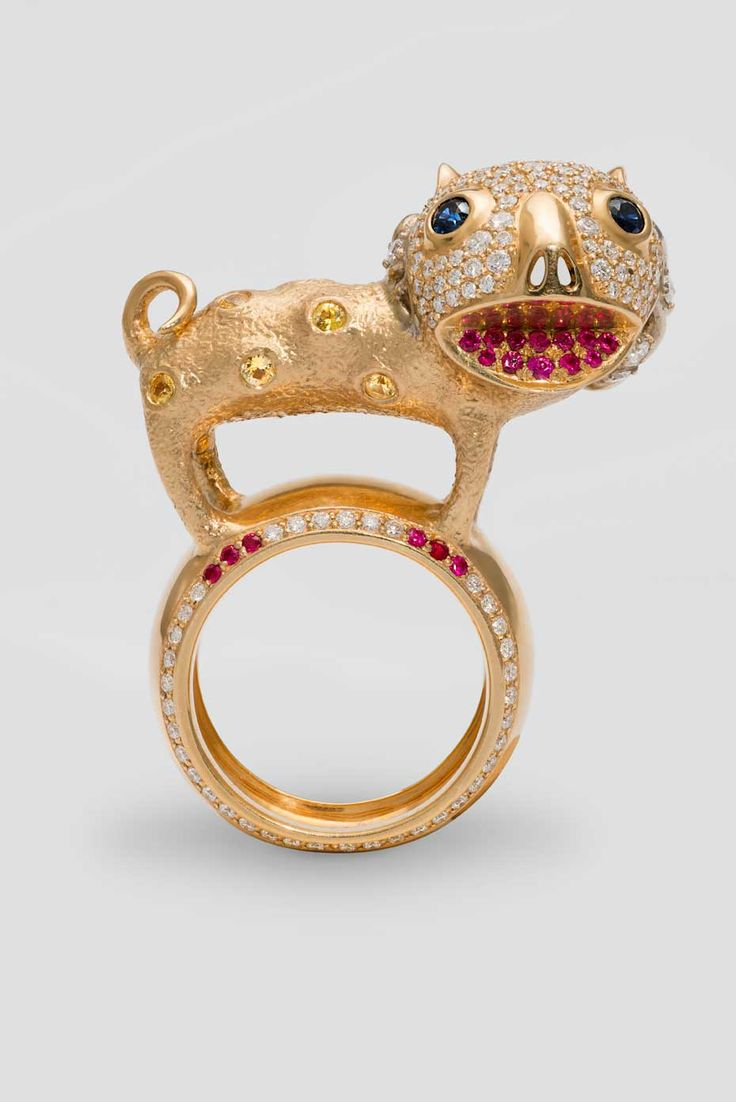 Dashi Namdakov Lion ring in white and yellow gold with diamonds, rubies and sapphires.