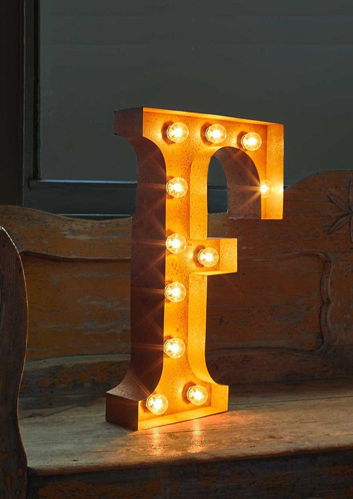 Our Fairground Letter Lights have a modernistic, yet vintage feel. This large metal letter F with its rough edges and exposed bulbs adds plenty of character to any room.