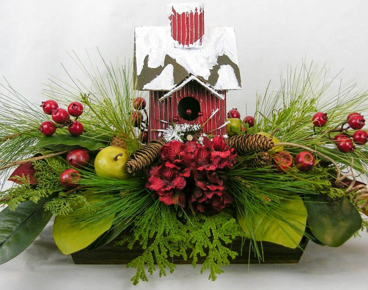 """The style of this arrangement is not specific to Christmas and will last all through the winter season. Center stage is a Raz snow covered 11""""H birdhouse. Only the highest quality of designer florals                                                                                                                                                                                  More"""