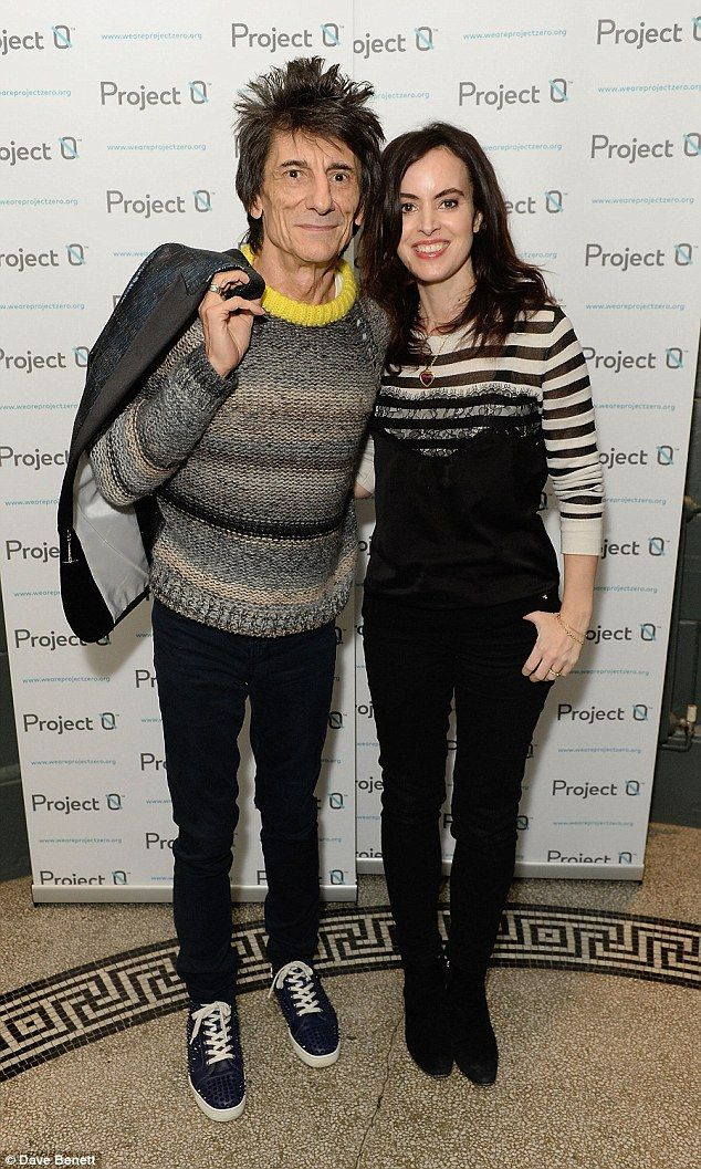 Content: Ronnie Wood, 68, and his wife Sally, 37, could hardly look happier with their cur...