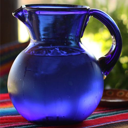 Our most popular hand blown glass pitcher. cobalt blue. mexico fair trade