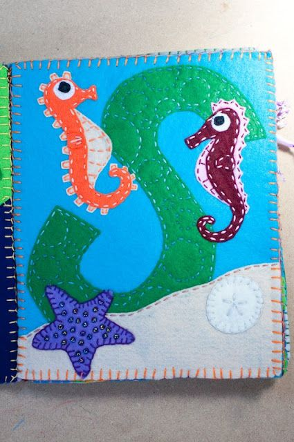 ooo cute i could do this in my hide and seek quiet book, with seahorses behind seaweed and shells...