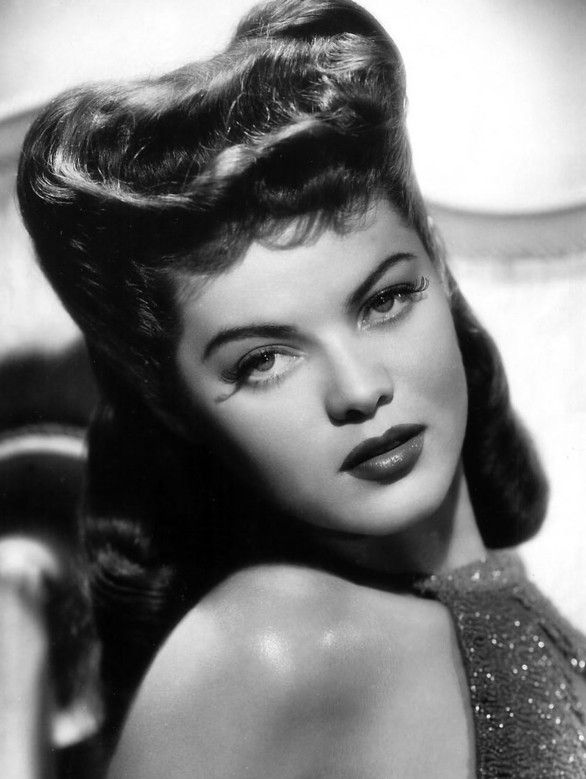 Dona Drake. 1940's I love the hair. I hope the 40's style comes back around, It was great for hair, shoes, clothes, grace.