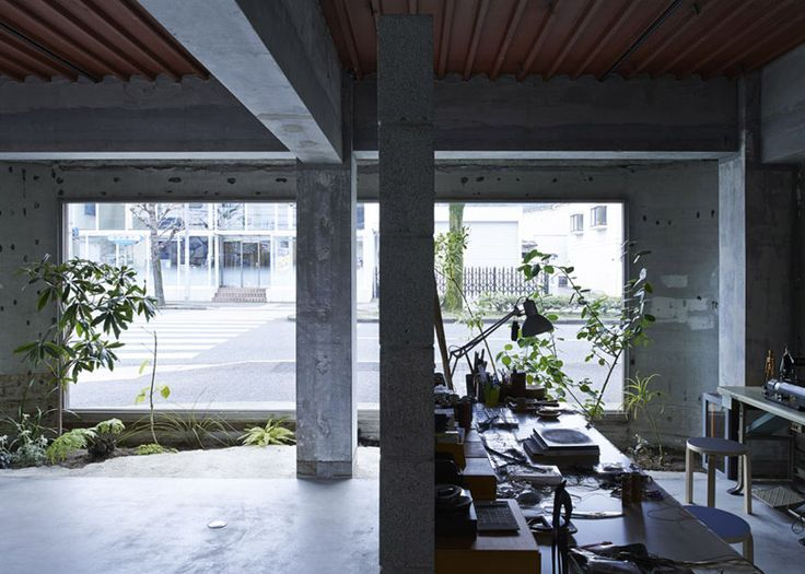 Smears of paint and plaster are left exposed on the walls of this design studio in Japan.