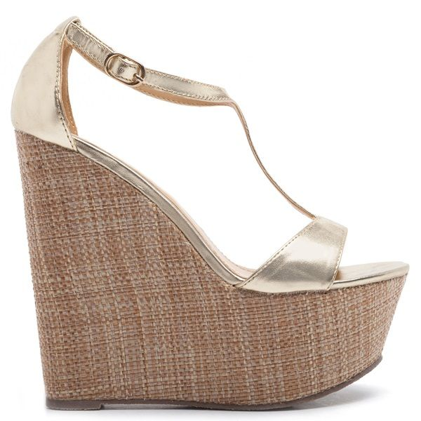Gold platform with cross-over straps. Fasten with adjustable strap around the ankle.