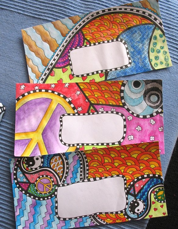 Hand drawn and hand painted Peace and Love envelopes by Press for Design.