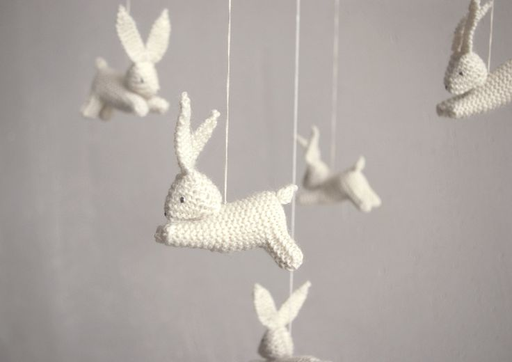 knitted bunnies mobile. To hang over the changing table to keep her occupied.