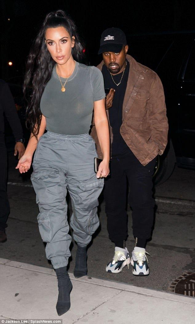 a705464258f9c Stylish  Kim paired her grey T-shirt with grey colored satin pants...   kimkardashian  yeezy