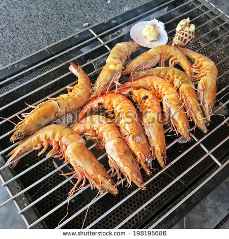 delicious grilled king prawns  by lazybuffy, via Shutterstock