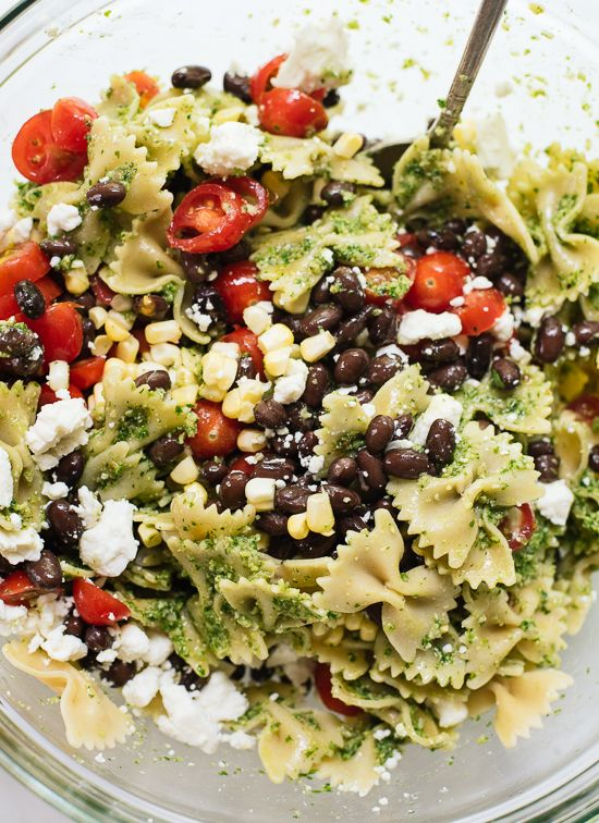 Healthy pasta salad featuring bold summer flavors, including tomatoes, corn and black beans tossed in fresh pesto! It's a great vegetarian side dish.