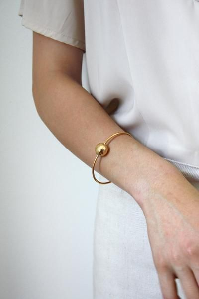 A hand fabricated cuff. Available in gold plated or sterling silver. Made by hand in Richmond, VA. Ready to ship in 1-2 business days. Jewelry Care