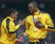 Jamaica's relay team members Yohan Blake and Usain Bolt (R) stand on the podium after receiving gold medals for the men's 4x100m relay at the victory ceremony at the London 2012 Olympic Games at the Olympic Stadium August 11, 2012.