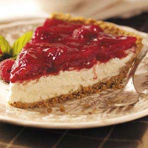 """Lemon Raspberry Cheesecake Recipe -Toasted sesame seeds add crunch to the graham cracker crust of this luscious dessert. """"Years ago, I led a homemaking course on dairy foods, and this pie was adapted from one of the recipes I used in that class. Everyone always wants seconds."""" —Audrey Armour, Thamesford, Ontario"""