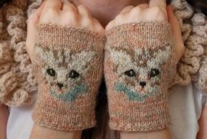 Precious kitty knit wrist warmers.