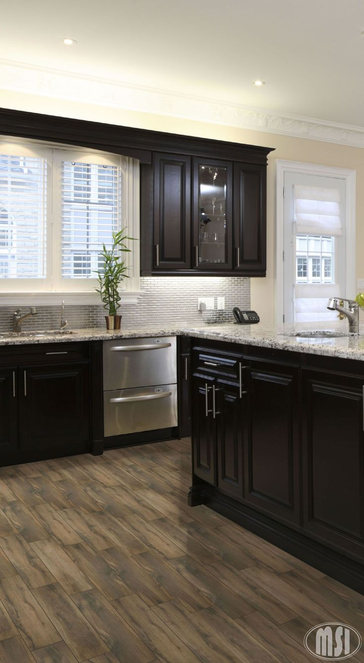 Moon White Granite Dark Kitchen Cabinets And Light Wood Flooring