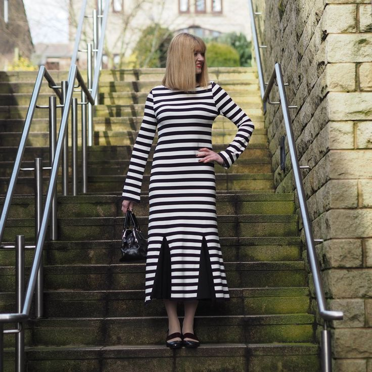Black and white striped midi dress with godet detail