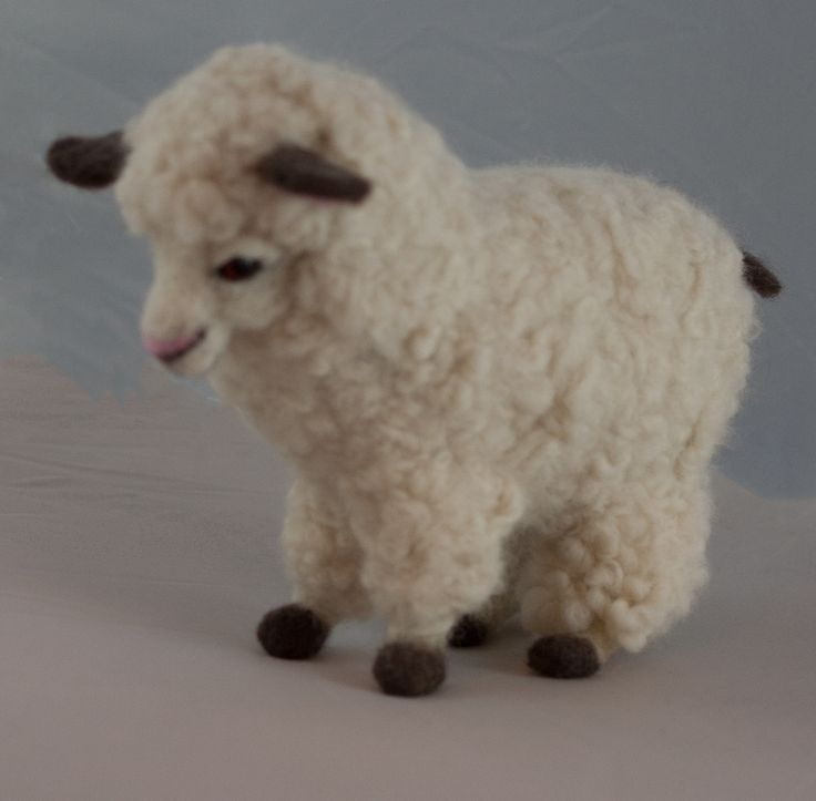 Pom pom sheep.  This little guy started out on a hairpin loom.  The legs were done in separate pieces.  I wasn't excited about the way it looked when I was finished, so I just grabbed a skein of pencil roving and went to town.