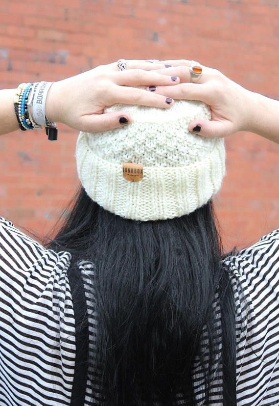 Unique one off handknitted fisherman hat in Cream. Knit in a textured moss stitch for extra snugness! Each piece is knit by hand in our North Wales studio so every hat is unique. Finished with a Junkbox Ultraleather tag. Wool/Acrylic blend. Unisex style. One size fits all. THE Winter