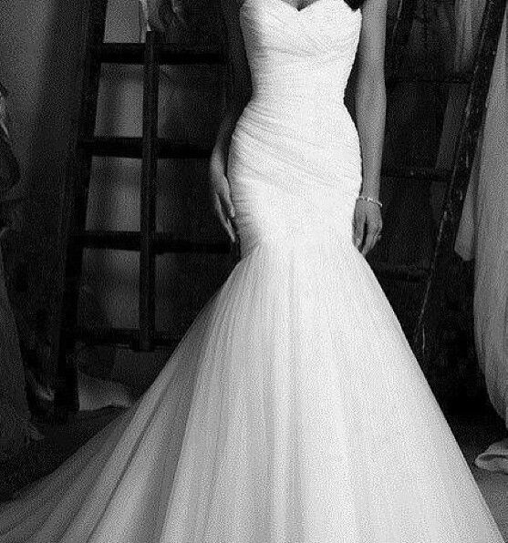 Tight fitting wedding dress.... The fit of this dress is what I want.