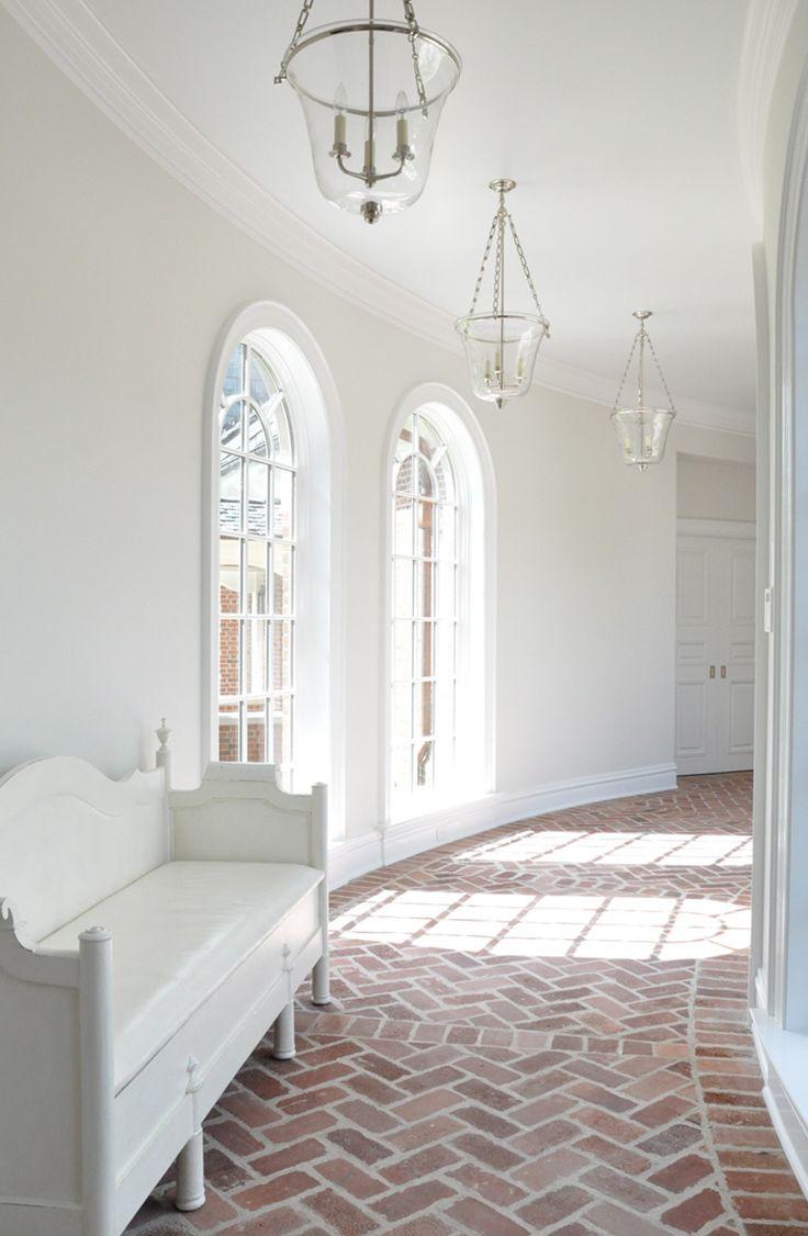 white walls | glass lanterns | floor to ceiling arched windows | brick herringbone pattern floors | Kathleen Clements Design