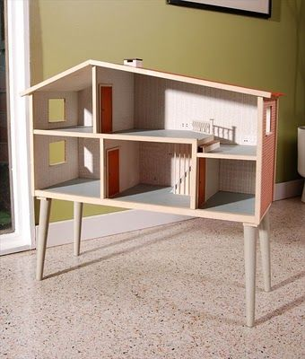 Such a sweet little dollhouse. I like the idea of just putting a dollhouse on similar legs also.