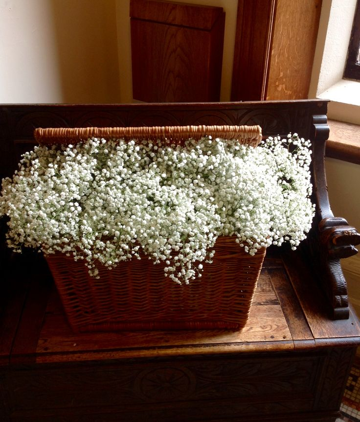Rustic picnic basket of gyp by Miss Mollie's Flowers