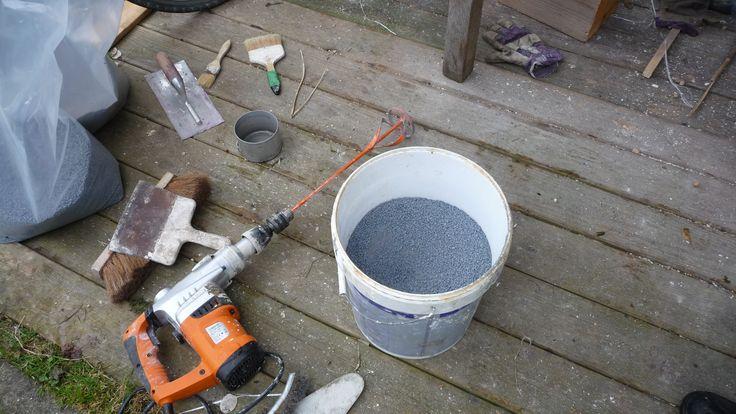 Le mélange de la résine et des sables colorés