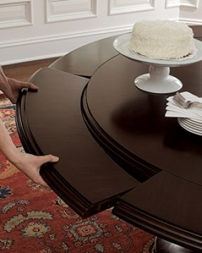 """Sienna Round Dining Table in mahogany; 56"""" diameter; 72"""" with leaves."""