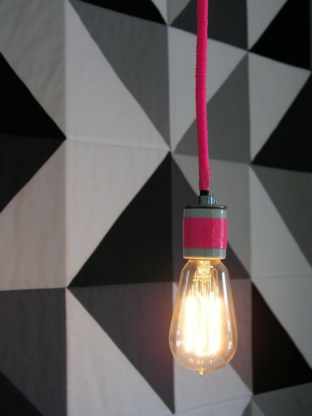 In any simple plain bathroom- instead of a solitary dull bulb hanging- why not give it a twist with colored chord?