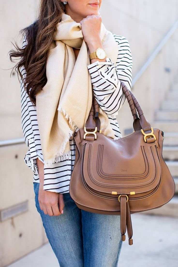 Striped top, large brown leather bag, scarf