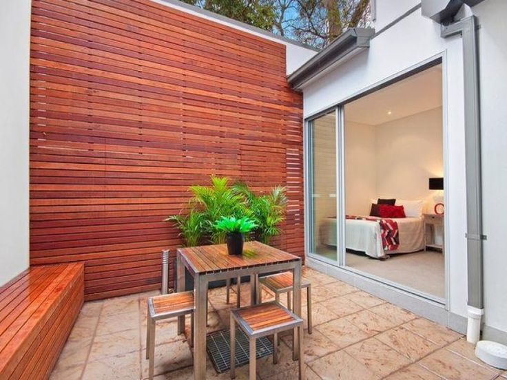 Idea for using a wood slat overlay to conceal an existing for Outside feature wall ideas