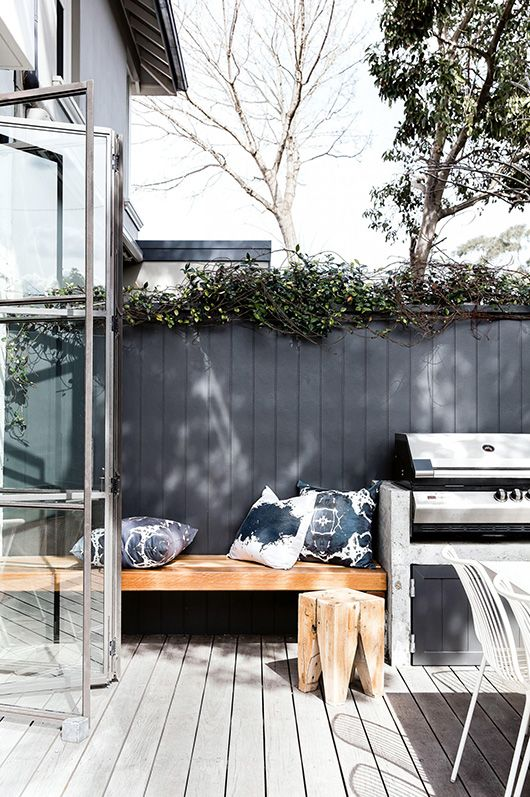 outdoor patio with throw indigo pillows and wood bench / sfgirlbybay
