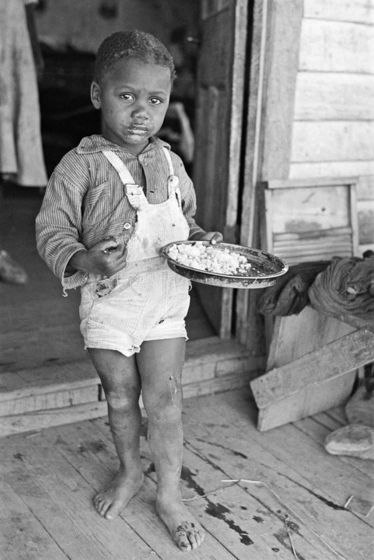 by Russell Lee - Child of sharecropper, Southeast Missouri Farms, 1938