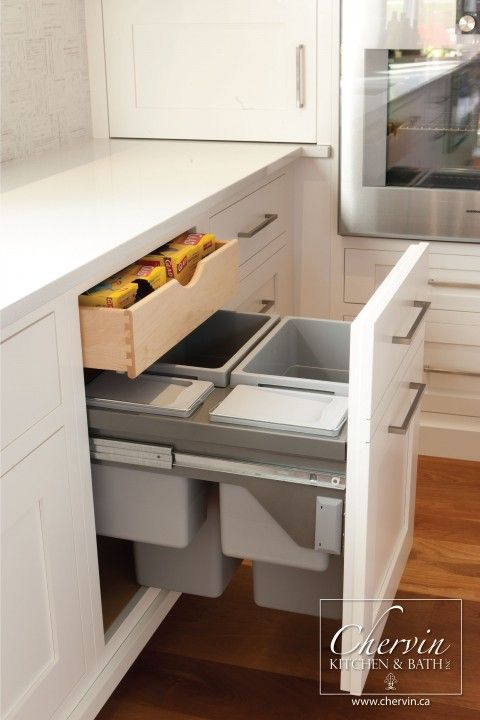 Beautiful two bin garbage drawer with pull out drawer above for bags and other storage. #kitchenorganization