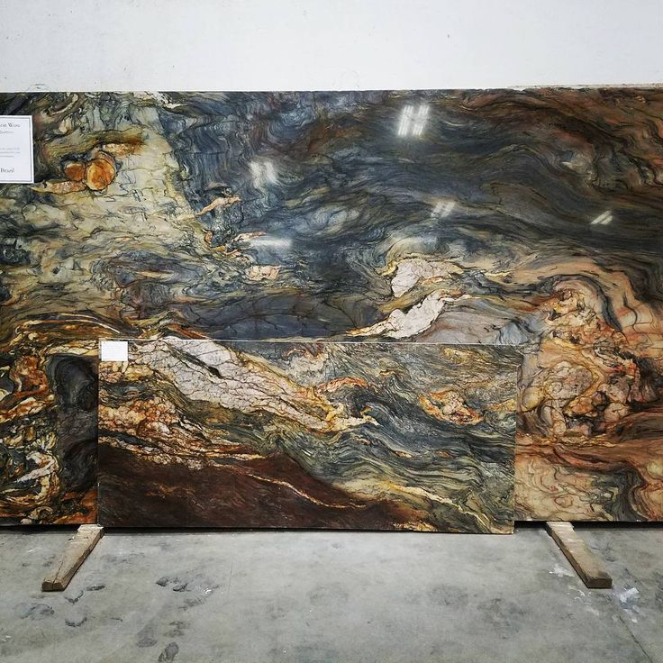 Fusion Wow Quartzite Granite.. Unbelievably beautiful. Too beautiful for just counterops, I would specify this for a grand shower, floors, art!