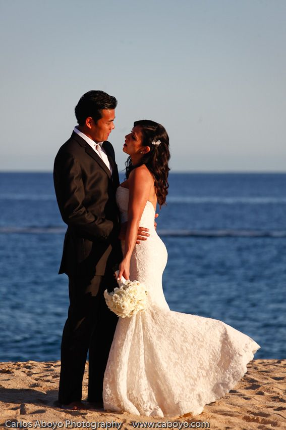 Love the mermaid dress with the ivory lace over a blush under layer Vanessa picked for her Pedregal beach wedding