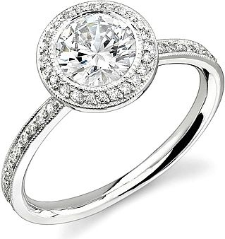 Stardust Bezel Round Halo Ring (SD N17211) found on Since 1910. [I would really love an inexpensive (non-engagement) version of a ring like this for my right hand!]