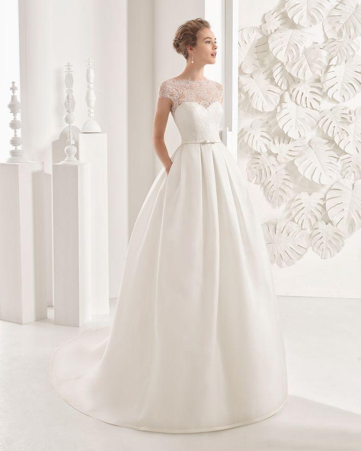 Couture-Brautkleid mit Oberteil aus Netzstoff und Rock aus Organza / Mikado-Seide. Rosa Clará Kollektion 2017.