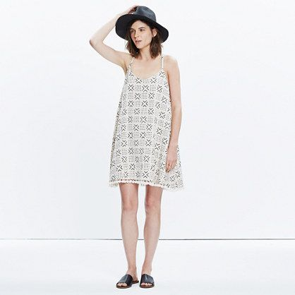 Trimmed in knotted tassel ties, this swingy cover-up dress has a low back with a sexy horizontal strap detail. We're big fans of the geometric print with its playful hand-drawn feel.  <ul><li>True to size.</li><li>Falls above the knee.</li><li>Cotton.</li><li>Machine wash.</li><li>Import.</li></ul>