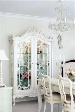 ooh, I love everything about this...the china cabinet, the table, the chairs, the chandelier...the color...