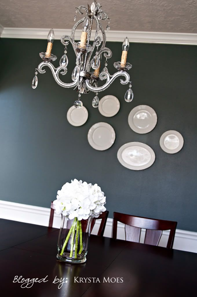 Grey with a blue undertone. The color is Homberg Gray by Sherwin Williams.  Painting my living room in this color.